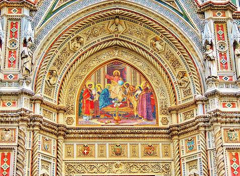 Marble artwork above Facade of the Duomo by Ravi S R
