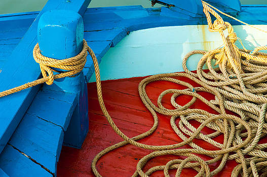 Marine Rope Tied Around The Boat's Pole With Lots Of Spare Lengt by Jirawat Cheepsumol