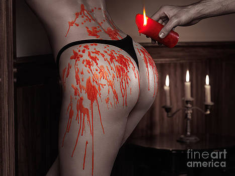 Melted red wax dripping from candle on sexy woman body by Oleksiy Maksymenko
