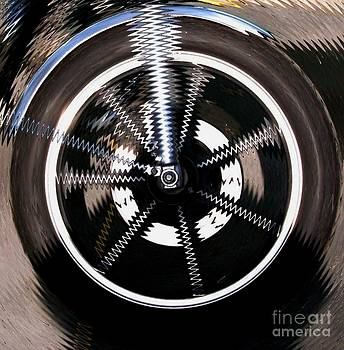 Gail Matthews - Motorcycle Wheel in a Spin