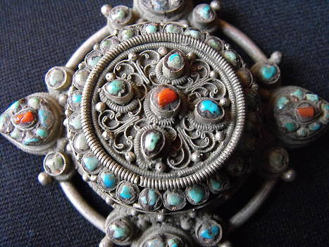 Nepali-Tibetan silver pendant with a central covered container by Anonymous artist