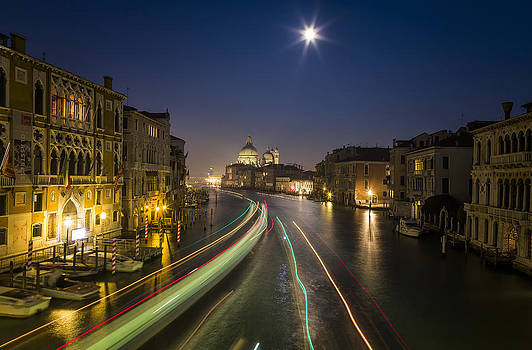Night View of Venice with Blurred Motion of Boats by Francesco Rizzato