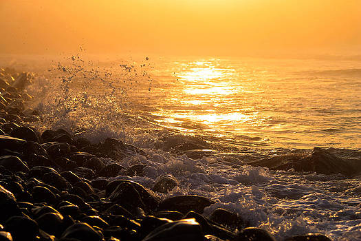 Ocean sunrise by Sybil Conley