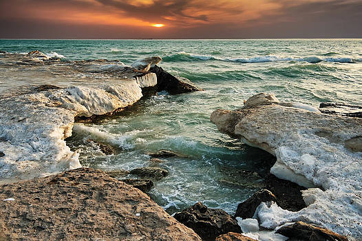 Ocean waves lapping at a shoreline by Alexandr  Malyshev