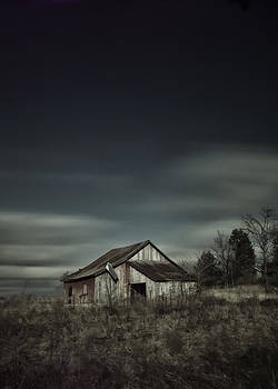 Old barn with passing clouds by Michael Huddleston