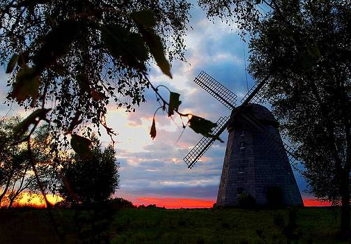 Old windmill in the evening by Juozas Mazonas