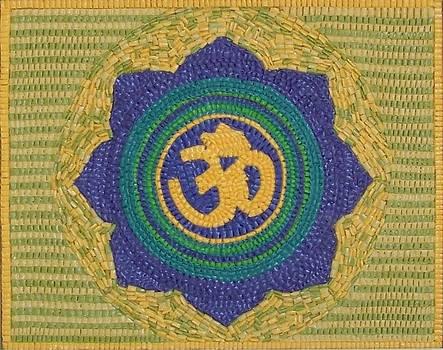 Om symbol in lotus flower by Paul London