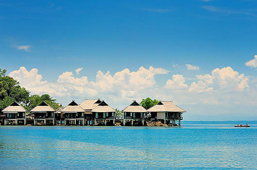 Over water bungalows with steps into amazing green lagoon by Keerati Preechanugoon