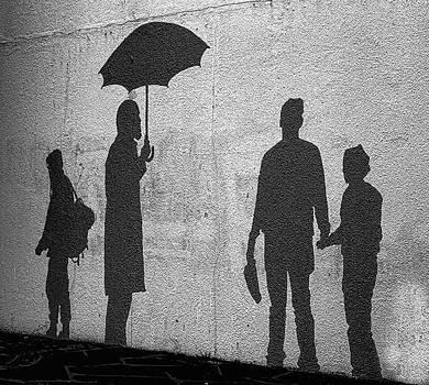People on the wall. by Konrad Ragnarsson