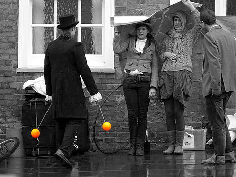 Performance in the rain by Chris Cox