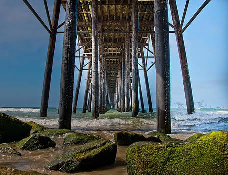 Piering into the sea by Vanden King
