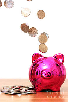 Piggy bank saving with money pouring into it by Simon Bratt Photography LRPS