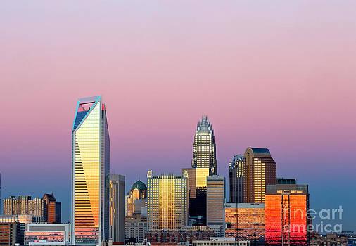 Pink purple sky over Charlotte skyline by Patrick Schneider