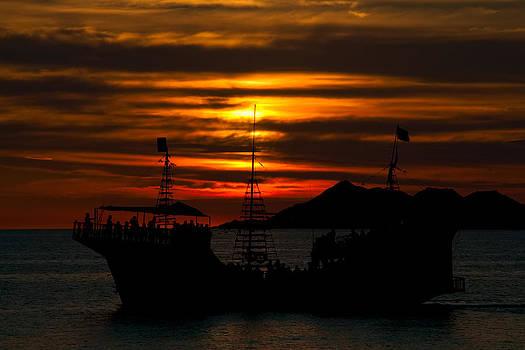 Pirate ship at sunset by Robert Bascelli