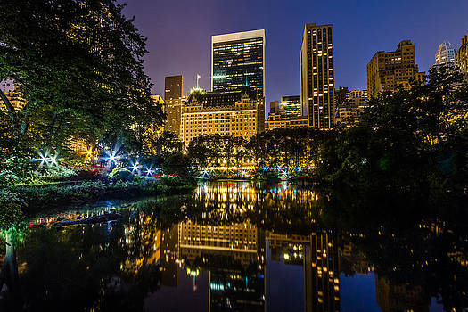 Plaza Hotel Reflected in Central Park Pond by Val Black Russian Tourchin