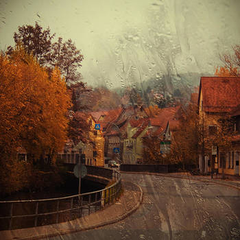 Rain in small town by Igor Isachenko