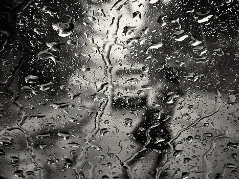 Rainy day woman by Jonathan Wilkins