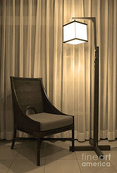 Rattan Chair With Warm White Lamp And Curtain by Pakorn Kitpaiboolwat