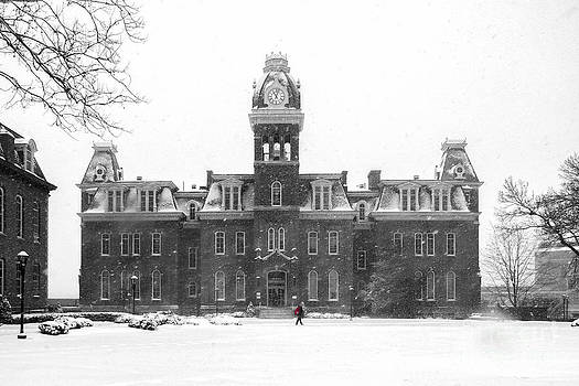 Dan Friend - Red backpack in snow storm Woodburn Hall