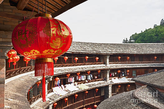 Red Chinese lantern in a Hakka Tulou  by Fototrav Print