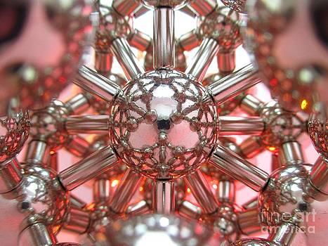 Red-orange Magnetic Lotus Flower by Mark Teeter