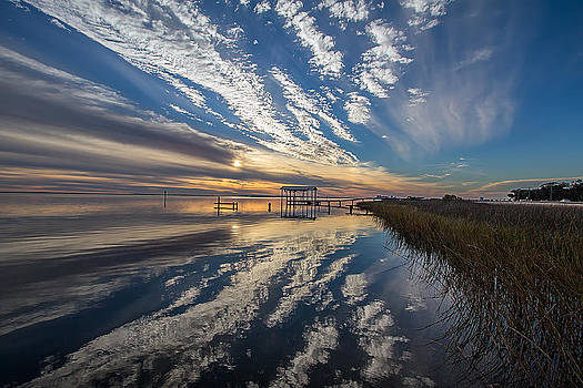 Reflecting sunset by Brian Wright