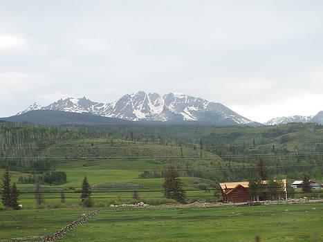 Rocky mountain cabin by John Morris