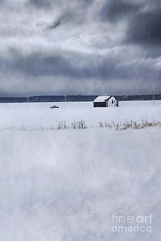 Sandra Cunningham - Rural winter scene of barn and truck from far away