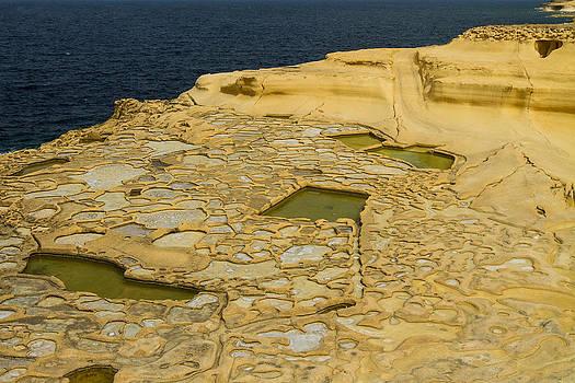 Salt pans on Gozo Island Malta by Gabor Pozsgai