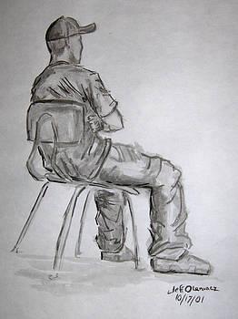 Seated Man in Ball Cap by Jeffrey Oleniacz