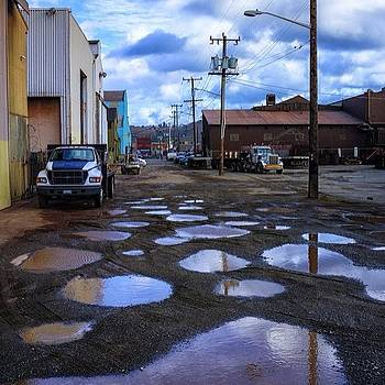 #seattle #sodo #puddles by Ron Greer