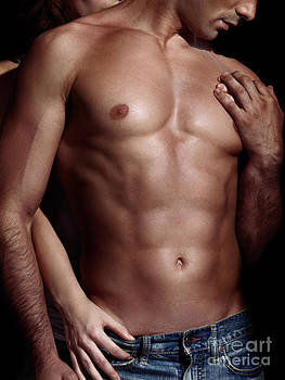 Sexy couple Woman behind man with sexy muscular bare torso by Oleksiy Maksymenko