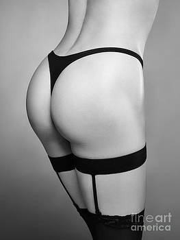 Sexy woman wearing stockings with suspenders closeup Black and w by Oleksiy Maksymenko