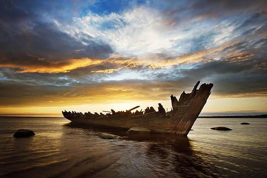 Shipwreck at sunset by Anna Grigorjeva