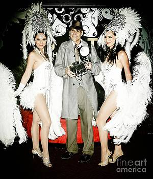 Showgirls and photographer with Polaroid by Nina Prommer
