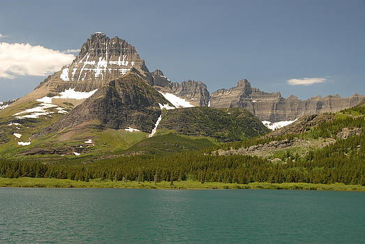 Snow and Water in Glacier National Park by Larry Moloney