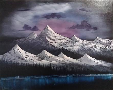 Snow capped peaks by Jared Swanson