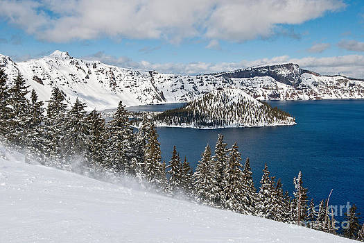 Jamie Pham - Snow Flurry - Crater Lake covered in snow in the winter.
