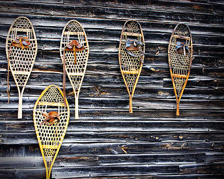 Snowshoes On A Wooden Barn by Norman Pogson