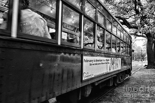 Kathleen K Parker - St. Charles Ave Streetcar Whizzes By-black and white