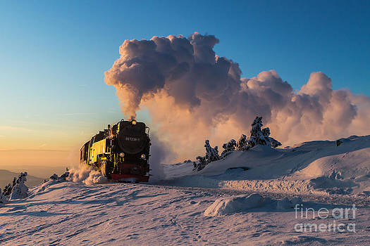 Steam train at sunset by Christian Spiller