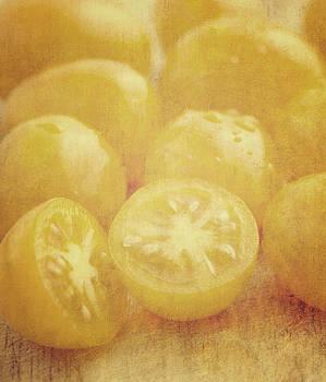 Still life of yellow plum tomatoes by Lars Hallstrom