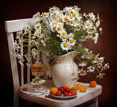 Still-life with white wine both fresh berries and a magnificent bouquet from gentle camomiles in a w by Marina Volodko