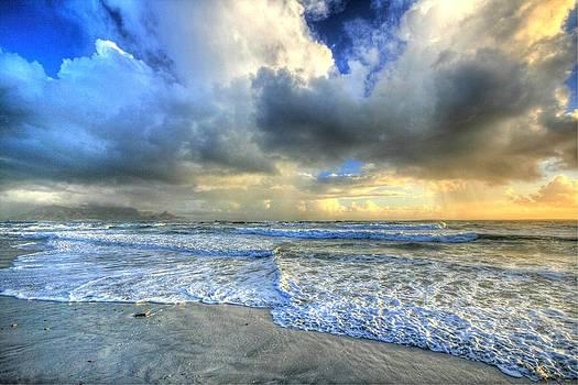 Storm on a beach by David Valentyne