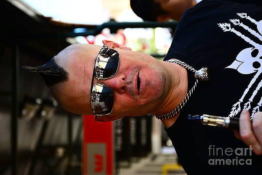 Street Performer Enjoying His Pipe Of Smoke 01 by Bobby Mandal