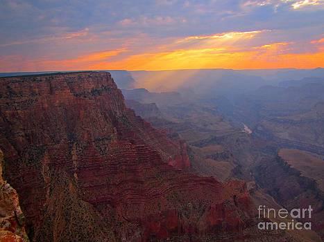 John Malone - Sunbeams Illuminating the Grand Canyon