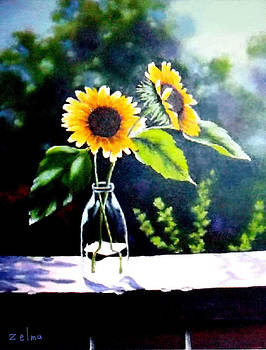 Sunflowers in clear vase by Zelma Hensel