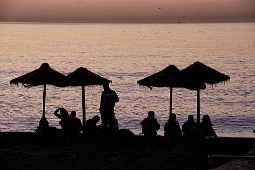 Sunrise on the beach after a night out by Goyo Ambrosio