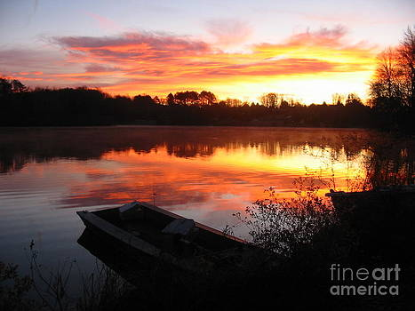 Sunrise on the lake by Janet Moses