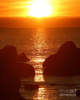 Sunrise Through The Rocks by Deborah  Smith